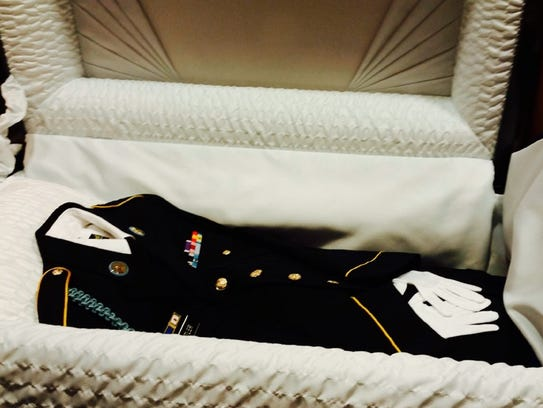 Nehemiah Butler's uniform, laid in a casket for his