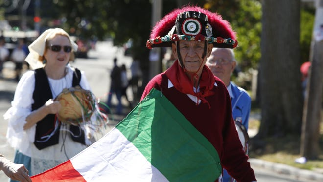 Members of I Paesani De Tramonti make their way along Seminary Avenue in the annual Yonkers Columbus Day Parade on Oct. 5, 2014.