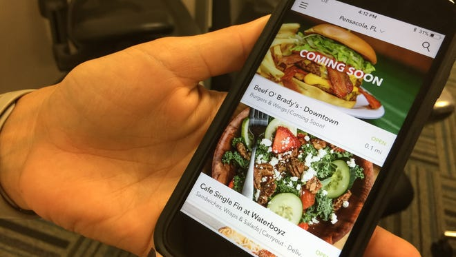Whitney Savoie, Waitr launch team marketing strategist, displays the company's food-delivery app on Monday, Sept. 25, 2017.
