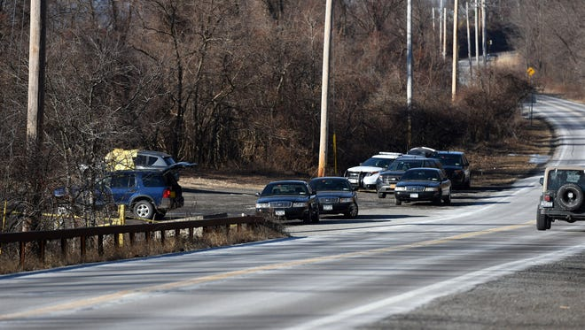 Police  investigate the scene where a man was found dead near Breakneck Ridge off Route 9D on Friday. Jan. 23, 2015