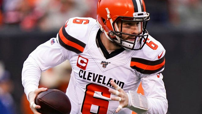 From Dec. 29, 2019, Cleveland Browns quarterback Baker Mayfield scrambles during the first half of an NFL football game against the Cincinnati Bengals in Cincinnati. The most compelling dramas in the NFL this season unfolded on the field, not off of it. And any thought that the league was in jeopardy of losing its spot as America's favorite sport has been set on the back burner.