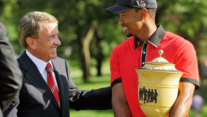 From Aug. 4, 2013, Tiger Woods, right, is congratulated by PGA Tour commissioner Tim Finchem after Woods won the Bridgestone Invitational golf tournament in Akron, Ohio. Woods and Finchem are part of the 2021 induction class for the World Golf Hall of Fame.
