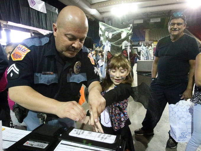 Camille Ambreit, 7, gets her fingerprints recorded
