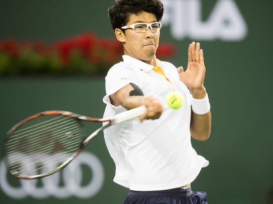 Hyeon Chung of South Korea  plays against Roger Federer of Switzerland on Stadium One during their quarterfinal match at the 2018 BNP Paribas Open at Indian Wells Tennis Garden on March 15, 2018. Federer won the match 7-5, 6-1.
