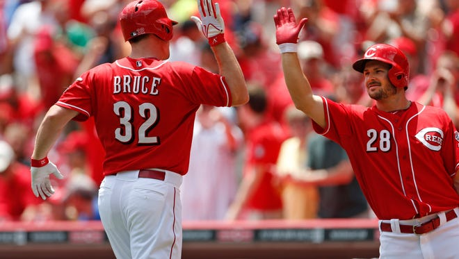 Reds right fielder Jay Bruce is congratulated by teammate Chris Heisey after hitting a home run during the first inning Tuesday.