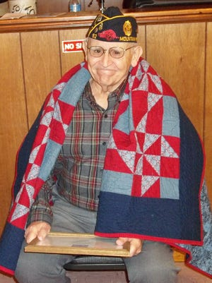 Don Owens, US Navy Vietnam veteran, recently received the Quilt of Valor at American Legion Post 52 by the Mountain Home Quilts of Valor.