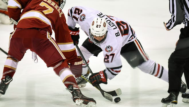 St. Cloud State's Blake Lizotte takes the faceoff during the Friday, Feb. 23, game against Denver at the Herb Brooks National Hockey Center in St. Cloud.
