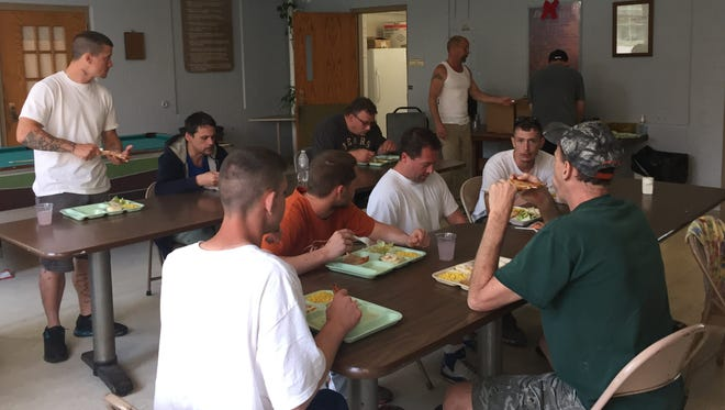 A group of men dine at the Hope House in 2015. Hope House provides a homeless shelter and addiction recovery services for local men in need.