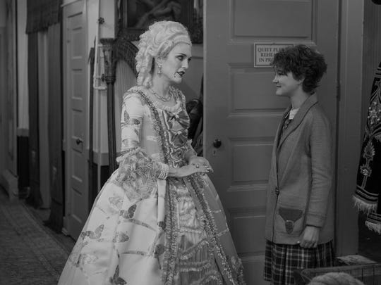 Silent-film star Lillian Mayhew (Julianne Moore, left) is surprised by a visitor, deaf heroine Rose (Millicent Simmonds), in 'Wonderstruck,' which is filmed partially in black and white.