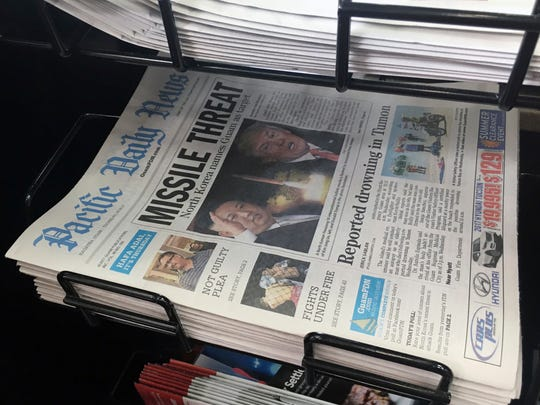 A copy of Pacific Daily News of Guam reflects heated rhetoric between North Korea and the U.S., including North Korea's threat to attack the U.S. territory.
