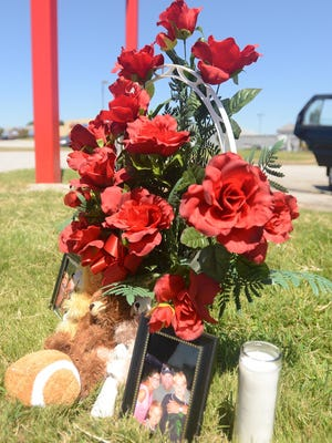 A memorial was set up on Vann Drive in memory of Jay and Julie Hogan on Saturday. The Hogans were involved in a fatal car accident Thursday.