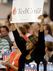 Sheila Houston holds up a sign during Republican presidential