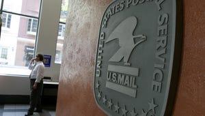 U.S. postal service logo.