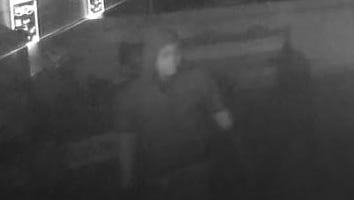 A man in a grey short-sleeve hoodie and black gloves is caught on a surveillance camera inside Chilitos Restaurant on Valley Drive about 1:30 a.m. Monday, Feb. 26. Chilitos was burglarized and vandalized early Monday morning.