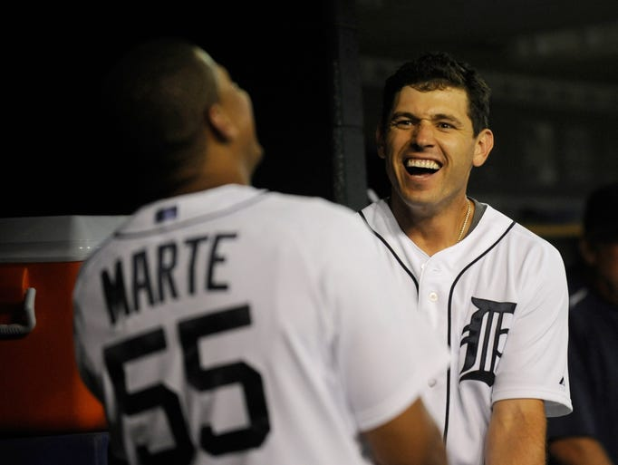 Tigers' Ian Kinsler (3) jokes around with his teammates