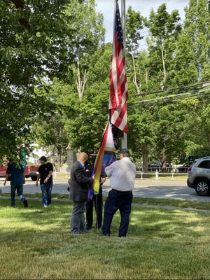 Wenham Deputy Police Chief Kevin DiNapoli, Town Administrator Anthony Ansaldi and Fire Chief Stephen Kavanagh raised the unity flag outside of the town hall.