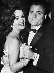 Elizabeth Taylor is seen dancing with producer Mike