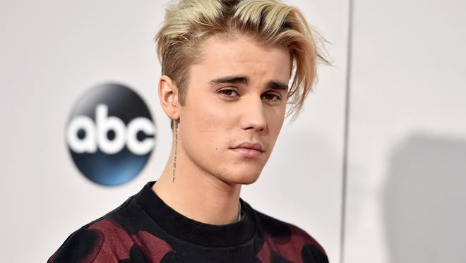FILE - In this Nov. 22, 2015 file photo, Justin Bieber arrives at the American Music Awards at the Microsoft Theater in Los Angeles. (Photo by Jordan Strauss/Invision/AP, File)
