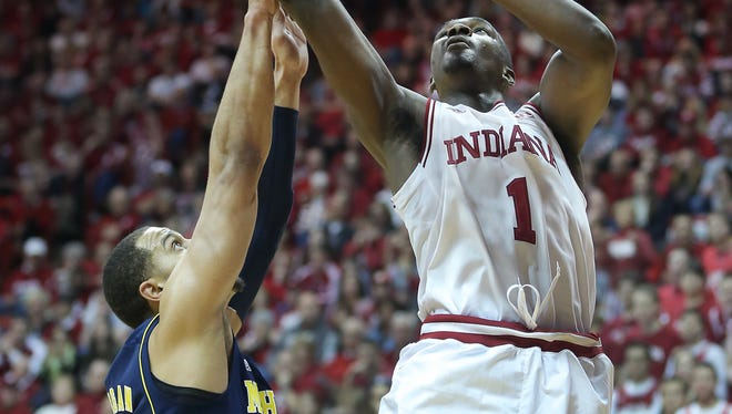 Noah Vonleh (1) posted his Big Ten-leading ninth double-double with Larry Bird watching, helping Indiana to an important win over No. 10 Michigan.