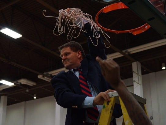 Brookdale men's basketball coach Paul Cisek cuts down