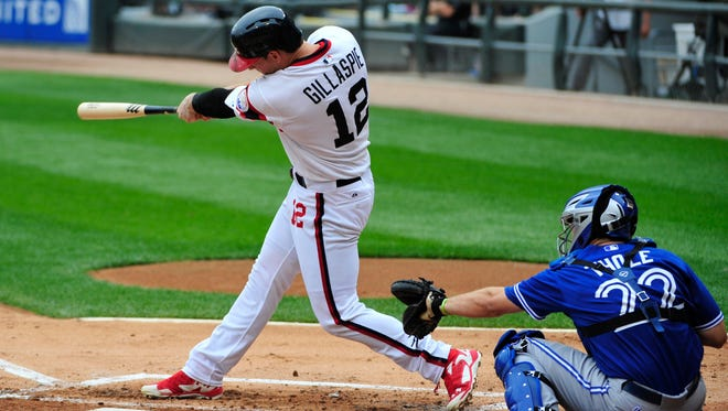Chicago White Sox third baseman Conor Gillaspie hits a grand slam home against the Toronto Blue Jays during the first inning at U.S Cellular Field.