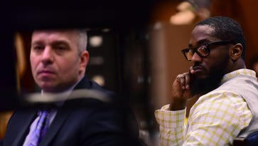 From left, Michael Rubas, the defense attorney, and Basim Henry, the defendant, watch a surveillance video inside a liquor store after the carjacking and the murder of Dustin Friedland, given by Ralph Amirata, Essex County Assistant Prosecutor, during his closing arguments to the jury. Attorneys conduct their closing arguments for Basim Henry's involvement in the carjacking and murder of Dustin Friedland at The Mall at Short Hills in December of 2013.
