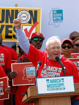 In this 2017 photo, UAW president Dennis Williams calls for auto workers to demand their rights during a speech before thousands gathered at a pro-union rally near Nissan Motor Co.'s Canton, Miss., plant.