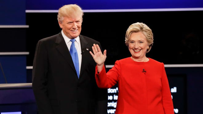 Republican presidential nominee Donald Trump and Democratic presidential nominee Hillary Clinton are introduced during the presidential debate at Hofstra University in Hempstead, N.Y., Monday.