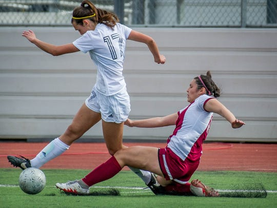 Ventura's Peyton Erickson is tripped by Paloma Valley's