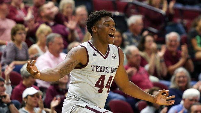 Texas A&M Aggies forward Robert Williams (44) celebrates on the sideline during the first half against the Buffalo Bulls at Reed Arena.