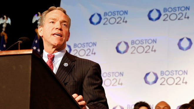 John Fish, Boston's bid chairman, speaks during a news conference in Boston Friday after Boston was picked by the USOC as its bid city for the 2024 Olympic Summer Games.