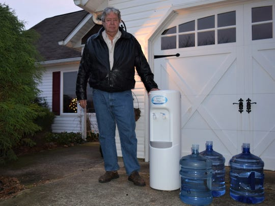 Robert Phillips, 70, is one of many Millsboro-area residents who opened their doors to a surprise water delivery this month. The water, provided on behalf of Mountaire Farms, came with no instructions and no explanation.