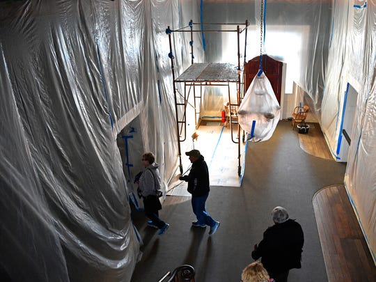 Tours continue as plastic sheeting covers the chandeliers