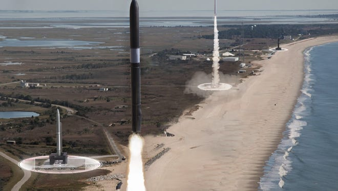 """This concept image shows the Defense Advanced Research Projects Agency's vision for """"responsive launch,"""" with multiple small rockets ready to launch in rapid succession from multiple sites on a range."""