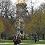 Students walk across the Notre Dame campus on Monday, April 20, 2009.