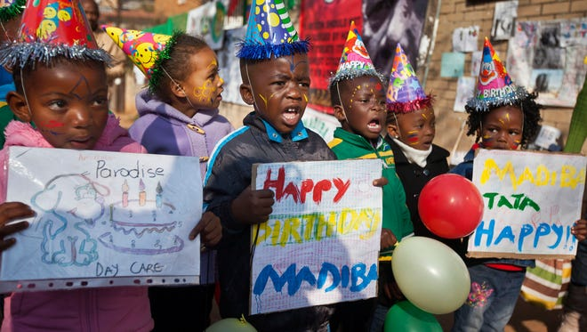 A group of kindergarten children singing Happy Birthday to Nelson Mandela outside the Mediclinic Heart Hospital in Pretoria, South Africa, on July 18, 2013.