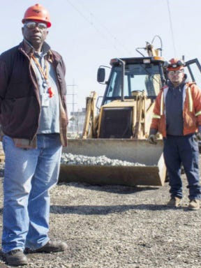 In this image from an April 2015 Amtrak newsletter, Amtrak workers Joe Carter (left) and Victor Mercado are shown. Carter died in Amtrak's crash in Chester, Pennsylvania, this month.
