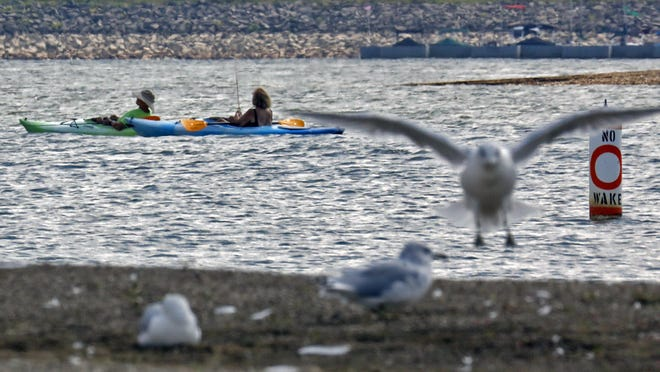 Kayakers enjoy an afternoon of fishing at Hoover Reservoir on Thursday.