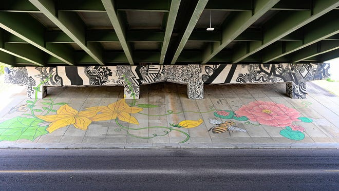 """""""Harrisburg Biome 1"""" by Wesley Stuart and Coleen Beyer is on the Calhoun Expressway underpass on the north side of Crawford Avenue. The couple was selected to receive the Greater Augusta Arts Council's 2020 Kath Girdler Engler Award for Public Art."""