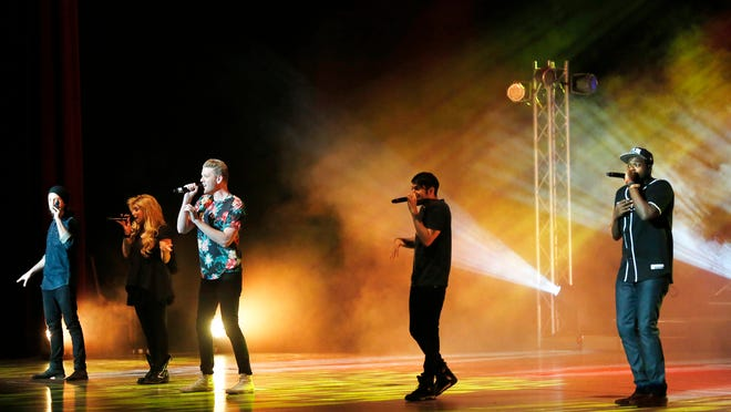 The popular a cappella group Pentatonix performs Wednesday at Elliott Hall of Music on the campus of Purdue University. Band members are Avi Kaplan, from left, Kirstie Maldonado, Scott Hoying, Mitch Grassi and Kevin Olusola.