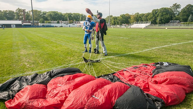 Panthers team Captain Jawan Mitchell collected the game ball delivered by professional Skydiver Dan Rizzo.