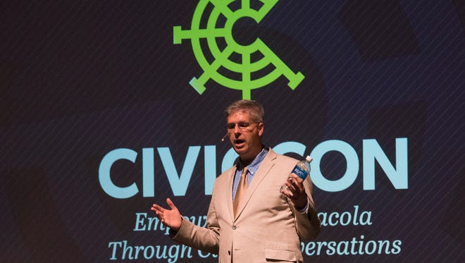 "Chuck Marohn, the author of ""Thoughts on Building Strong Towns,"" speaks to a capacity crowd gathered at the Pensacola Little Theatre during CivicCon  Wednesday, Sept. 26."