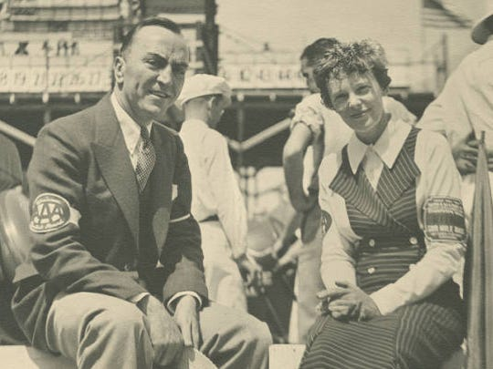 Amelia Earhart (right) and Eddie Rickenbacker at Indianapolis Motor Speedway in 1935. Earhart served as the first female referee for the Indianapolis 500.