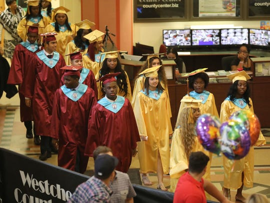Graduates process in as Mount Vernon High School held their 140th commencement ceremony, at the Westchester County Center in White Plains, June 22, 2018.