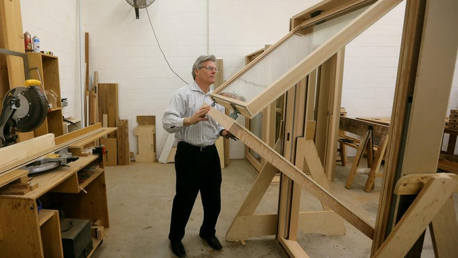 Tim Forster, a division director at Rochester Colonial Manufacturing, elicited help from RIT to design the company's FoldUp Window that uses a pulley and counterweights to open and close.