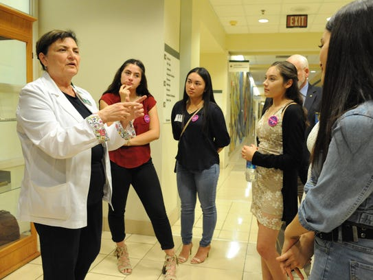 Natividad Medical Center Chief Nursing Officer Nancy Buscher gives students in the Everett Alvarez Interact Club a tour of the hospital after the students presented a check of more than $17,000 to the Wendy Baker RN Memorial Fund.