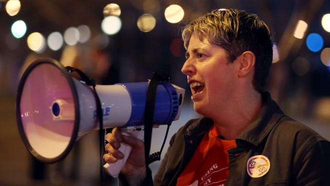 Amanda Kail, MNPS teacher and one of the organizers of the protest against Betsy DeVos outside Riverfront Park in Nashville, leads a chant Thursday. Alan Poizner/For the USA TODAY NETWORK - Tennessee Amanda Kail, MNPS teacher and one of the organizers of the protest against Betsy DeVos outside Riverfront Park in Nashville, leads a chant Thursday November 30, 2017.
