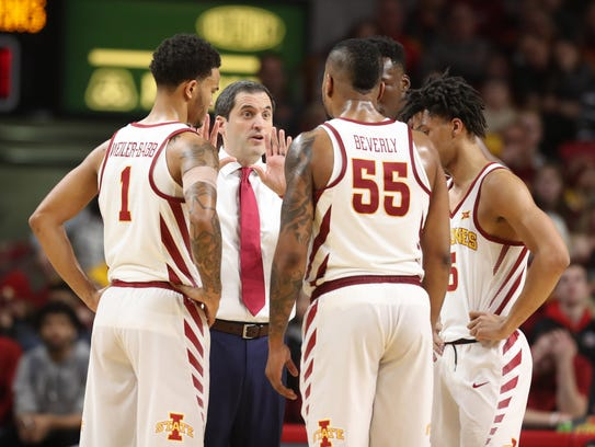Iowa State coach Steve Prohm talks to his team during their game against Texas on Monday.