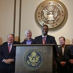 (l to r) Brenda Jones, Detroit city council president, Detroit Mayor Mike Duggan, Michigan Gov. Rick Snyder, former Emergency Manager Kevyn Orr (speaking), former Michigan State Senate Majority Leader Randy Richardville and Judge Gerald Rosen share a laugh while speaking to the press following Judge Steven Rhodes approval of Detroit's historic restructuring plan on Friday November 7, 2014 at the Federal Courthouse in downtown Detroit ending the largest municipal bankruptcy in U.S. history. Now the city is seeking $50 million from vendors paid before the July 2013 bankruptcy filing.