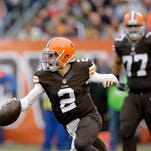 Cleveland quarterback Johnny Manziel scrambles against Cincinnati's defense during this past week's game.